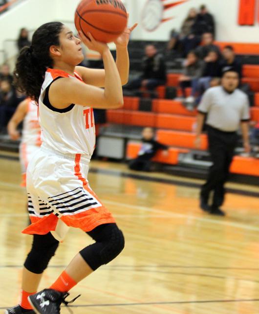 Junior, Victoria Peña, goes to the basket.