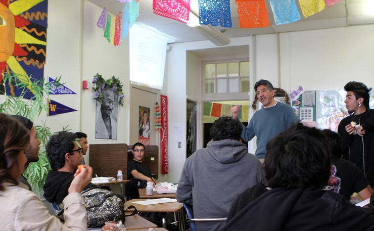 Xavier Miranda discussing plans for community garden with students.