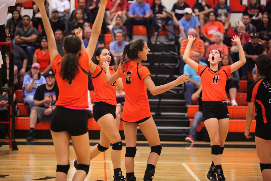 The+Tigers+volleyball+team+celebrates+after+defeating+district+rival%2C+Chapin%2C+on+Sept.12.+