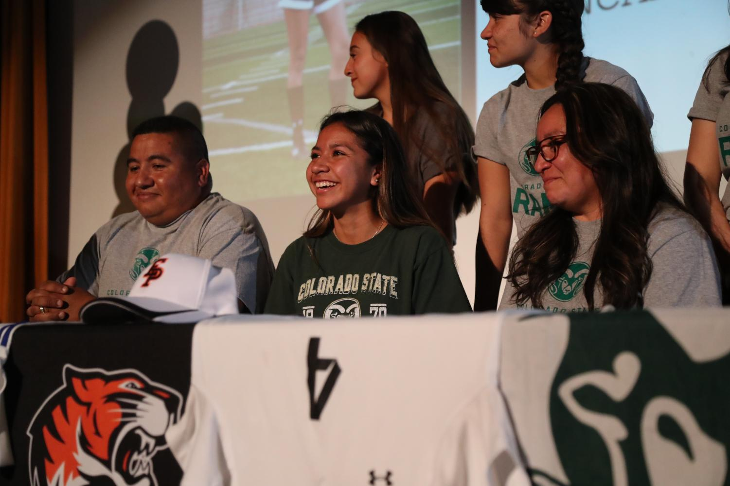 (Feb. 7, 2018) Jackie Balderrama (center) along side her parents looks in excitement as she signed her National Letter of Intent to play collegiate soccer at Colorado State University.