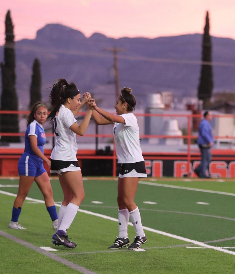Seniors Sonrisa Natividad (left) and Jackie Balderrama celebrate after a goal during their bi-district championship match against Bel Air on March 29.