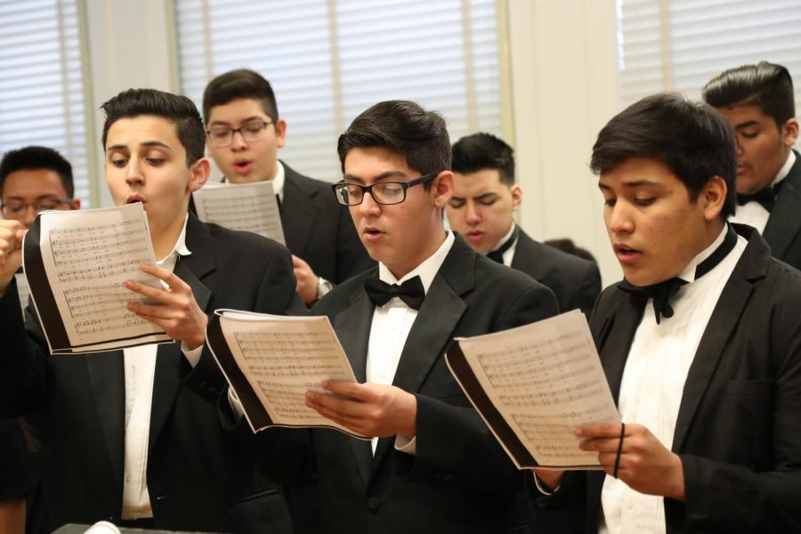 (Left to right) Carlos Hernandez, Angel Martinez and Sergio Avalos practice their songs prior to competition.