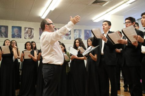 Choir director, Mr. Tim Thompson, helps his group prepare for UIL competition held at Eastlake High School on March 9.