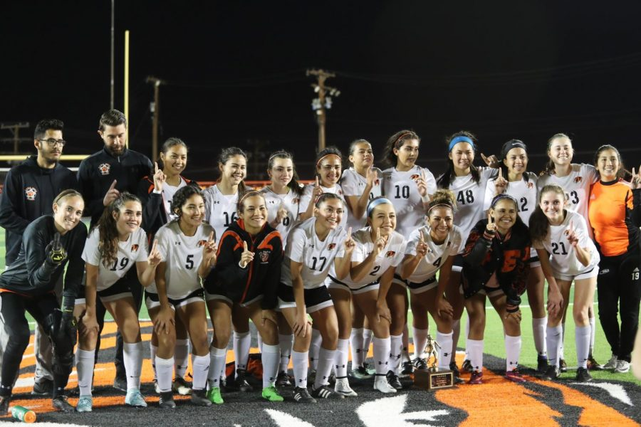The Tigers celebrate their bi-district championship after defeating Bel Air 2-1 on March 29.