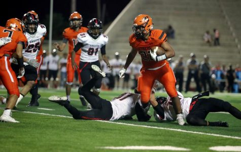 Senior running back, Mario Chavez, breaks through a tackle during the 39-13 loss to Hanks on homecoming night.