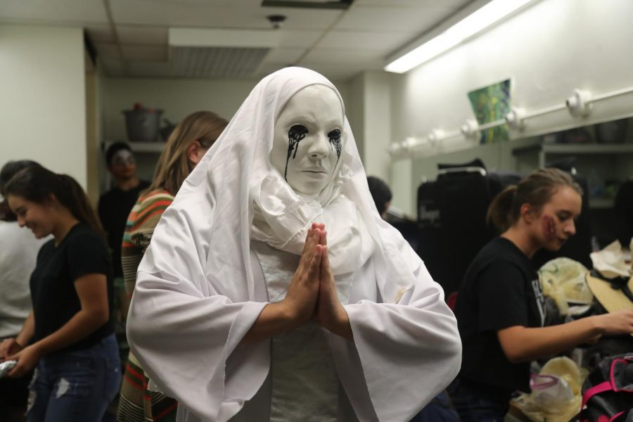 Sophomore, Pedro Gutierrez, dressed as a nun moments before the the haunted tunnel tours at El Paso High School.