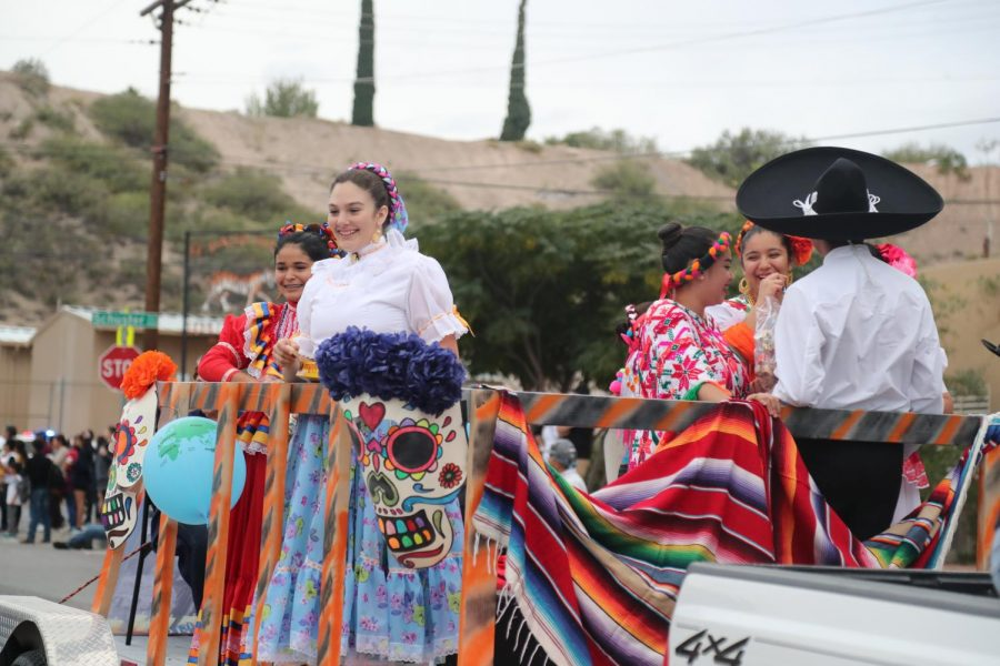 The folklorico dance team takes in the festivities during the 2018 homecoming parade.