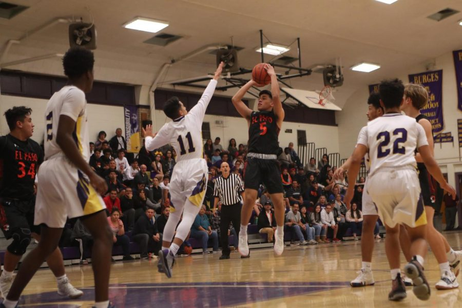 Senior, Nick Vega, goes ip for a contested jump shot against Burges.