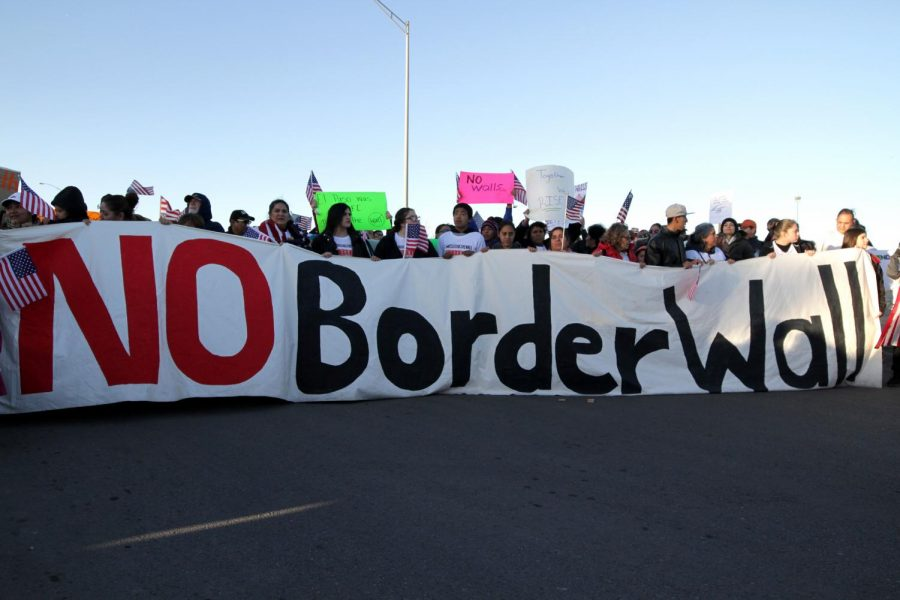 On Feb. 11, 2019 protestors prepare to walk from Bowie High School to Delta Park across from the El Paso Country Coliseum where President Donald Trump was holding a rally.
