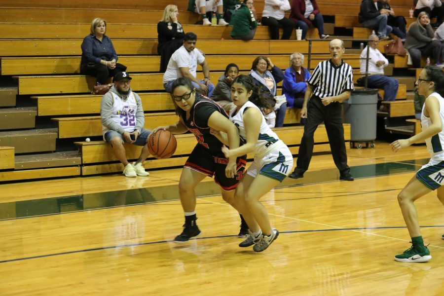 Senior, Isamara Arcos, droves down the baseline against Montwood on Dec 14, 2018.