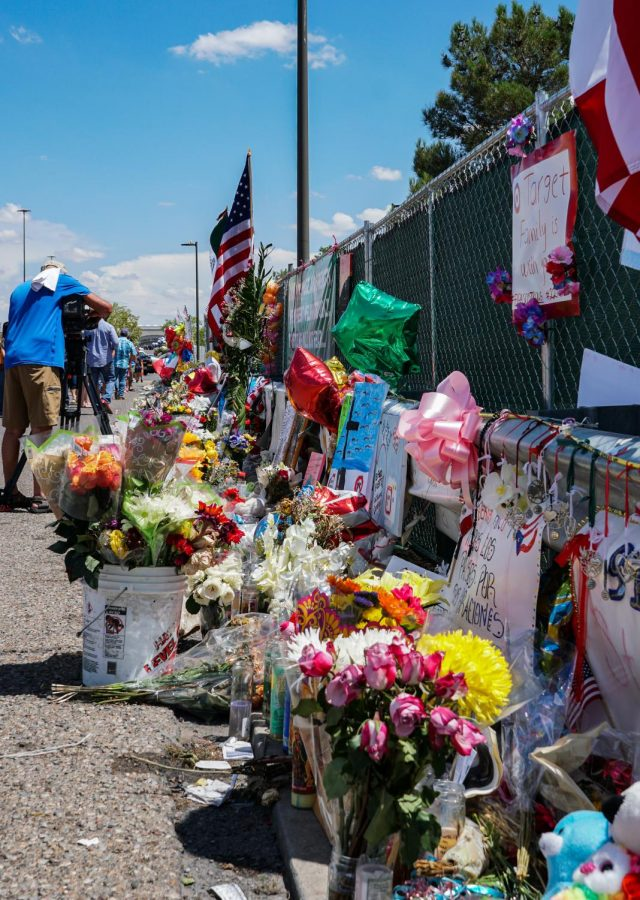 Hundreds of flowers adorn the makeshift memorial behind the Walmart next to Cielo Vista Mall where 22 people were shot and killed on Aug. 3. The site has received daily visits from people all across the region since the tragic event.