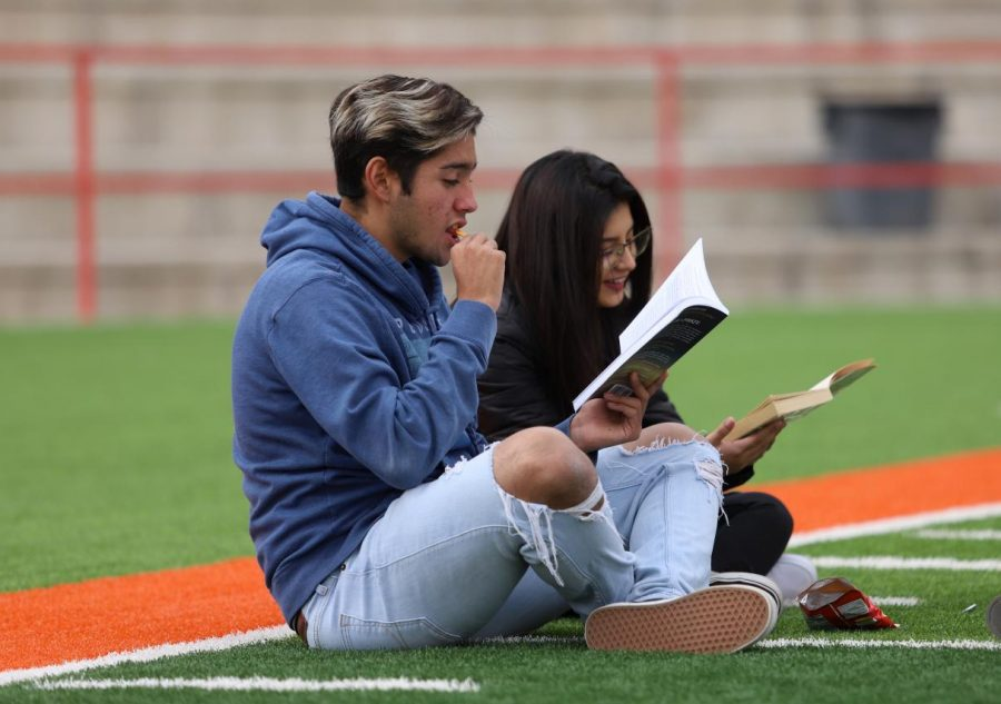 During the read across the district event on Nov. 8, seniors Sebastian Calderon and Denise Mendoza participate along with hundreds of other students in the field of R.R. Jones Stadium.
