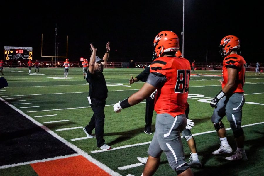 On Sept. 28, 2018, head coach, Robert Morales, celebrates with his players following a successful extra point attempt that gave the Tigers a 21-14 lead against Bowie before halftime. The Tigers defeated the Bears for the first time since 2011 with a final score of 31-20.