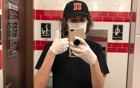 Senior, Pablo Catañeda, wears a safety mask and gloves as he continues to deliver food for Jimmy John's during the COVID-19 pandemic that has forced many businesses to close temporarily. Food services have been deemed essential during the pandemic.