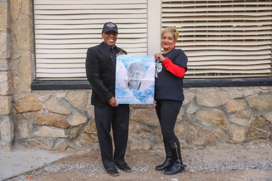 Command Sgt. Maj. Elliot and his wife Patricia Elliot, hold a picture of her uncle, Luis Juarez-one of the victims killed in the Aug. 3 shooting at Walmart.