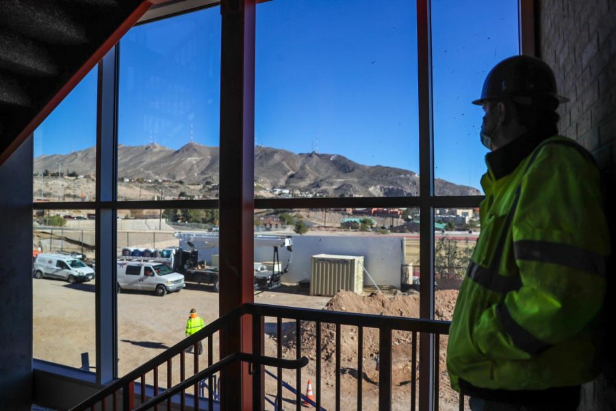 F.T. James Construction contractor Steve Michel looks out the windows of EPHS' new fine arts building facing the Franklin Mountains.