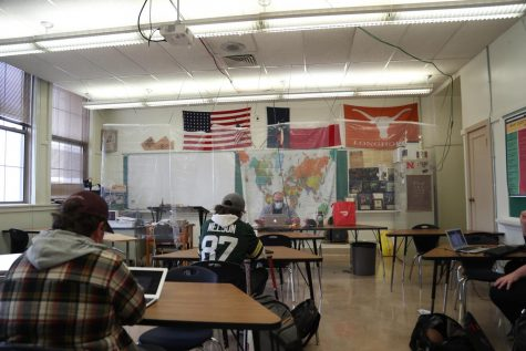 Jan. 21, 2021 - History teacher Mr.Russell Lang sits behind his desk as a plastic curtain separates him from the rest of his students during the first week of hybrid learning.