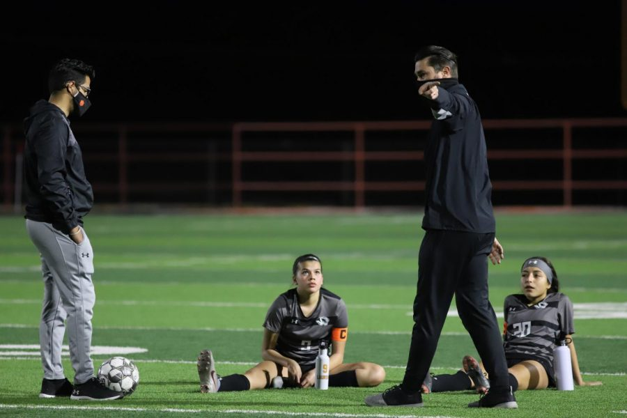 Seniors Lauren Lara (left) and Brianna Galvan discuss halftime adjustments with head coach Peter Fargo (center) and assistant coach Ryan Rodriguez during the Feb. 10 match up against Chapin.