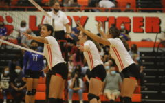 Yuliana Salazar, Diana Wong and Navi Orpinel set the floor during the Sept. 14 match against Bowie.