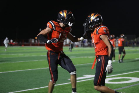 Senior receivers, Gabe Arreola (12) and Christian Carrillo celebrate after an overtime score during the 41-35 win against Irvin on Sept. 24.